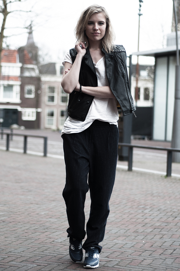 Fashion blogger wearing nike air max 90 blue slouchy suit pinstripe pants leather gilet waistcoat