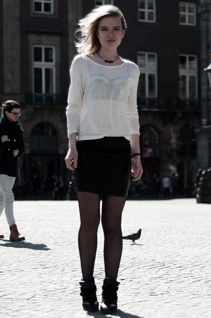 Fashion blogger wearing outfit leather skirt flash mesh fishet bra Isabel Marant KO sneaker wedges
