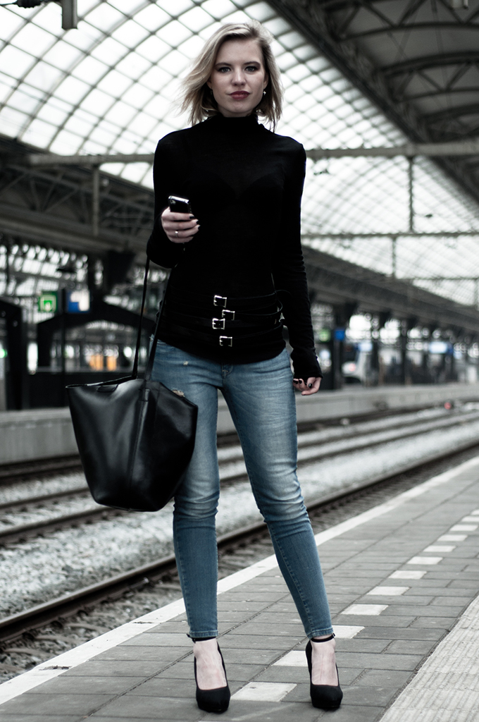 Black see through top light blue jeans killer heels