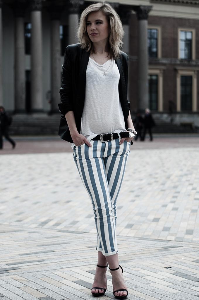 Blonde girl long legs blogger vertical stripes