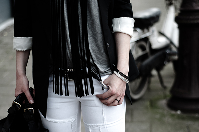 Details fashion blogger outfit white grey black patchwork jeans suede necklace