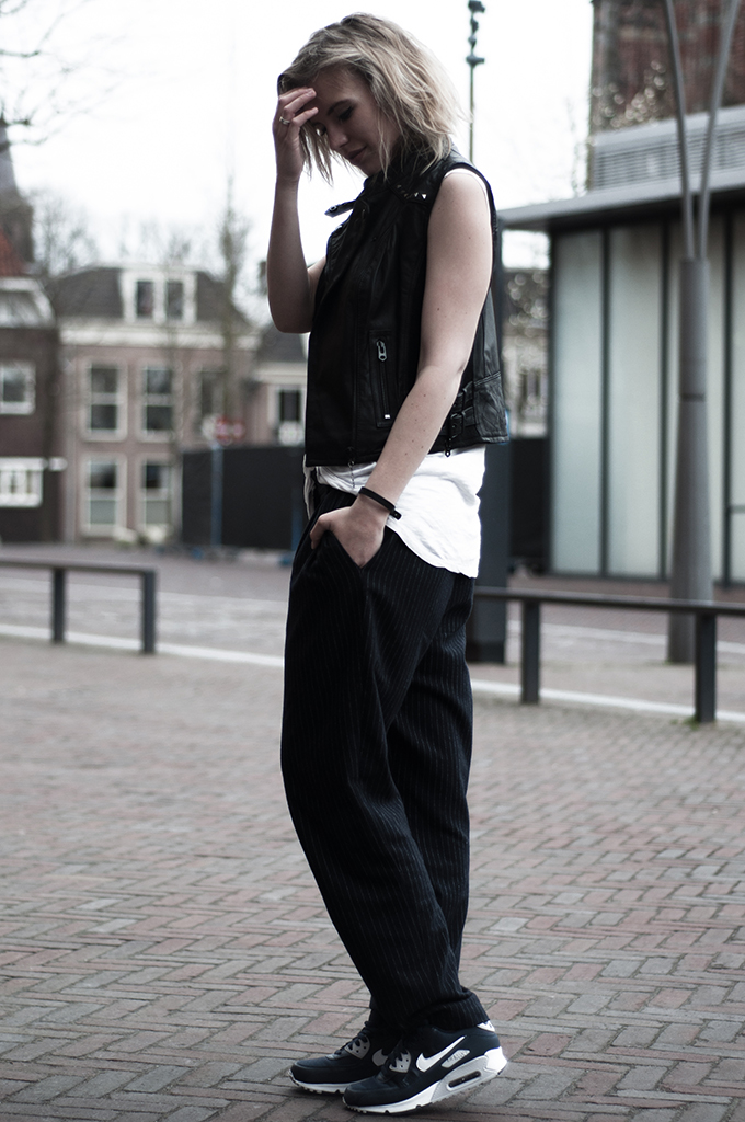 Fashion blogger blond girl rock chick messy hair leather biker gilet the sting nike air max