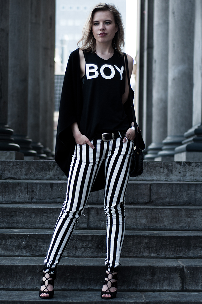 Model wearing Rihanna Boy London low cut armholes vest lace up sandals Zara