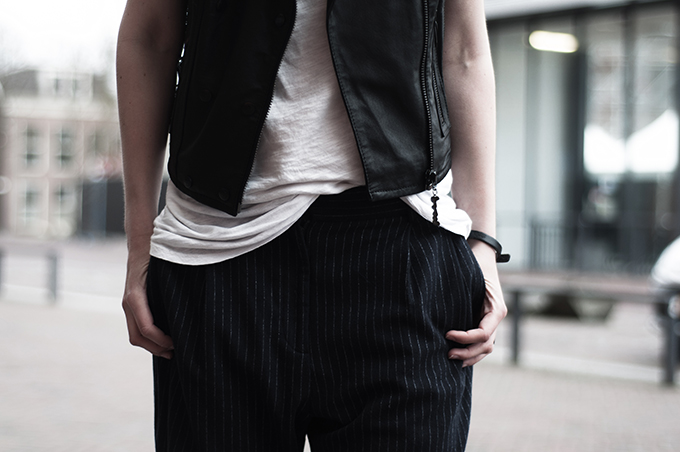 Details fashion blogger outfit pinstripe suit pants slouchy oversized leather biker gilet tee