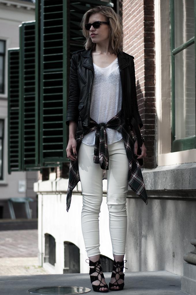 fashion blogger wearing checks checked lumberjack shirt tied around waist trend leather pants jacket