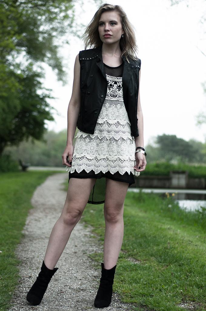 streetstyle outfit crochet chicwish dress fishnet mesh leather studded biker gilet model wearing