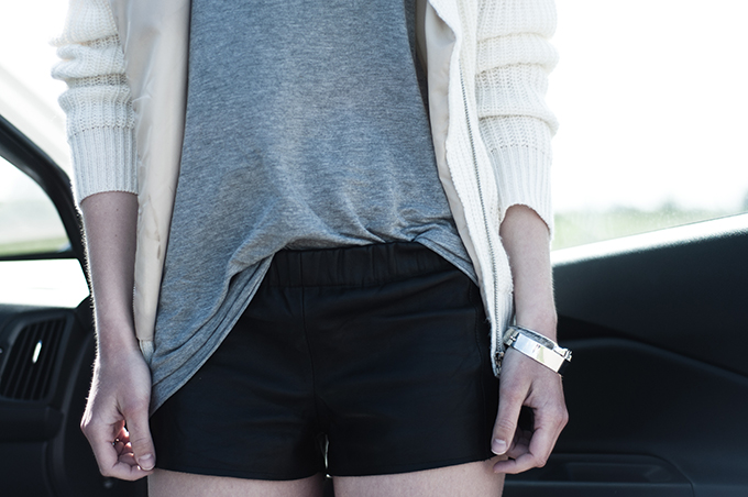 Fashion blogger outfit details leather shorts oversized tank tee top white nowhere knit jacket silver jewellery