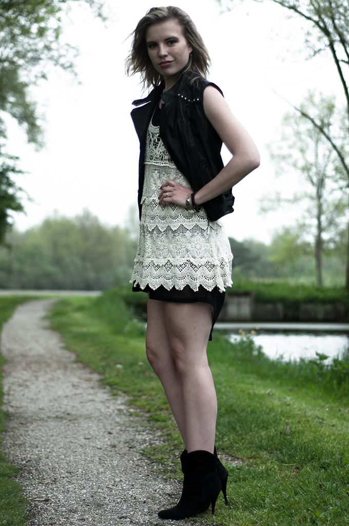 model girl wearing fashion outfit crochet lace dress fishnet mesh cream black leather