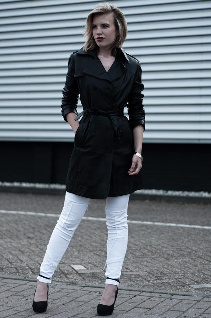 Long leather trenchcoat streetstyle fashion blogger wearing high heels kurt geiger carvela white jeans