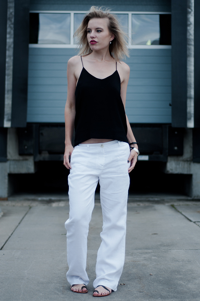 Fashion blogger outfit wearing céline inspired slouchy suit pants black and white flat sandals