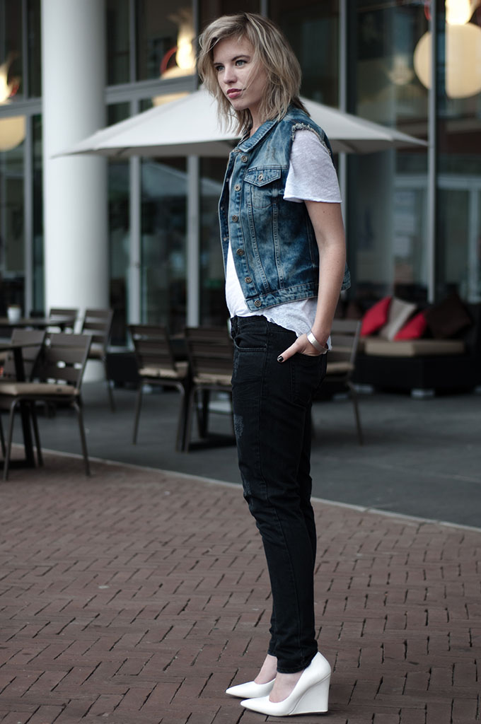 streetstyle fashion week issue 1.3 black distressed jeans ripped nelly denim on denim the sting waistcoat blue