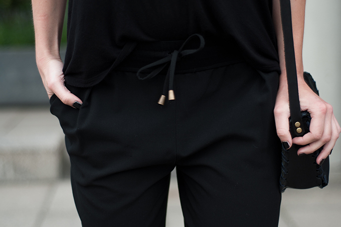 Outfit details all black everything slouchy pants WE fashion fashion blogger streestyle black nails little black bag