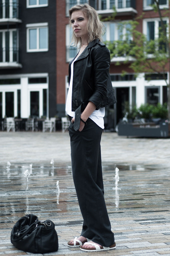 streetstyle model fashion week pinstripe pants oversized baggy slouchy leather biker jacket sacha H&M trend