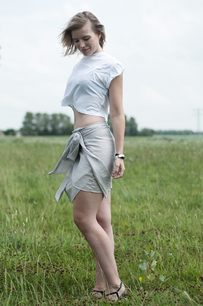 Fashion blogger wearing Charlotte Kan shirt skirt crop top easy breezy summer outfit comfy happy nude tones