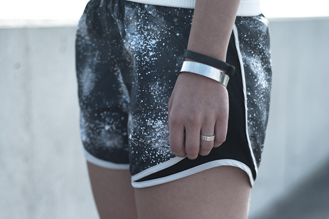 Fashion blogger outfit details Nike galaxy print tempo shorts running silver jewellery