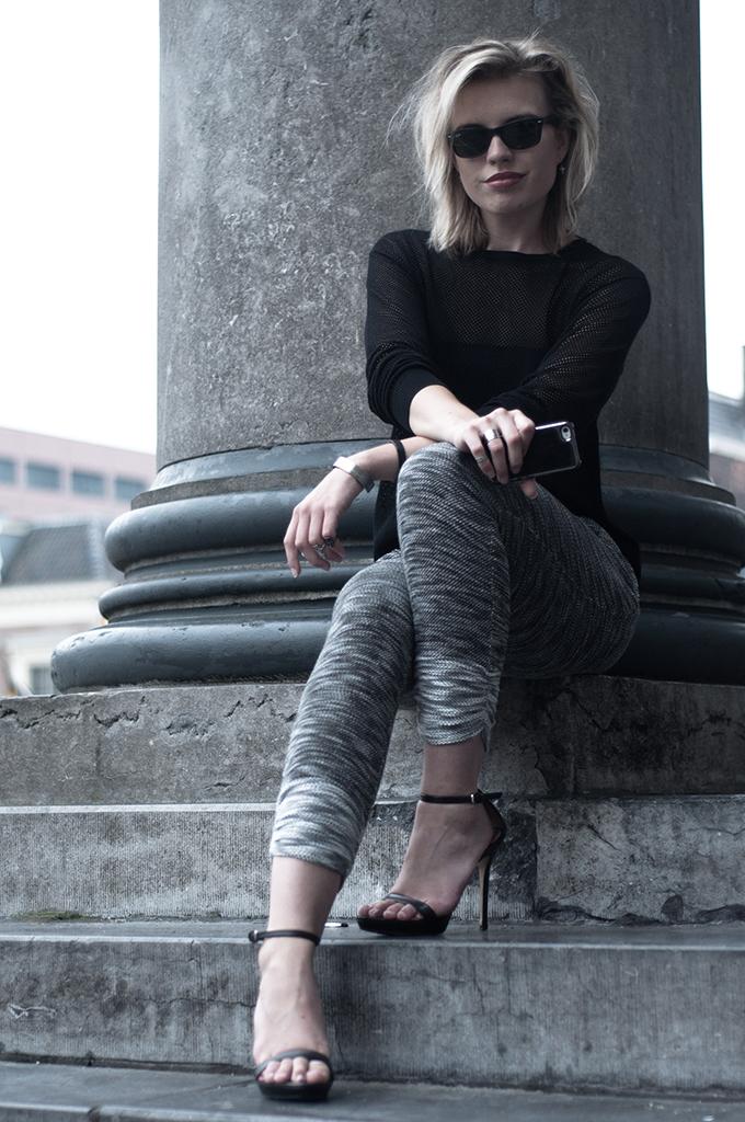 Fashion blogger rock chick edgy dark style outfit mesh fishnet grey black wayfarer ray-ban zara heels knitted pants