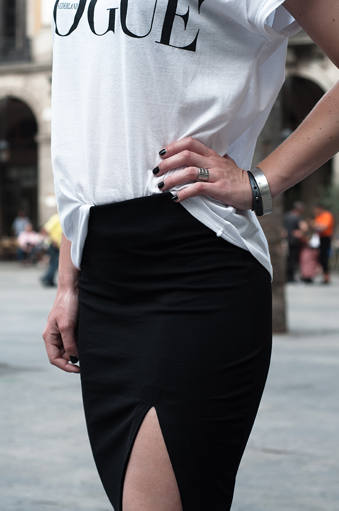 Edgy outfit details pencil skirt high side slit split bare legs silver cuff black nails Dutch Vogue tee the Netherlands magazine t-shirt