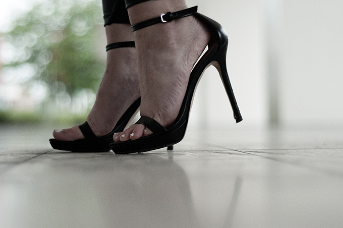 Outfit details fashion blogger wearing leather strappy sandals white nailpolish