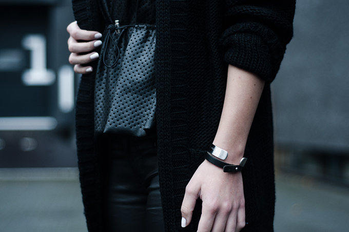 RED REIDING HOOD: All black everything different textures layers perforated peplum outfit details fashion blogger