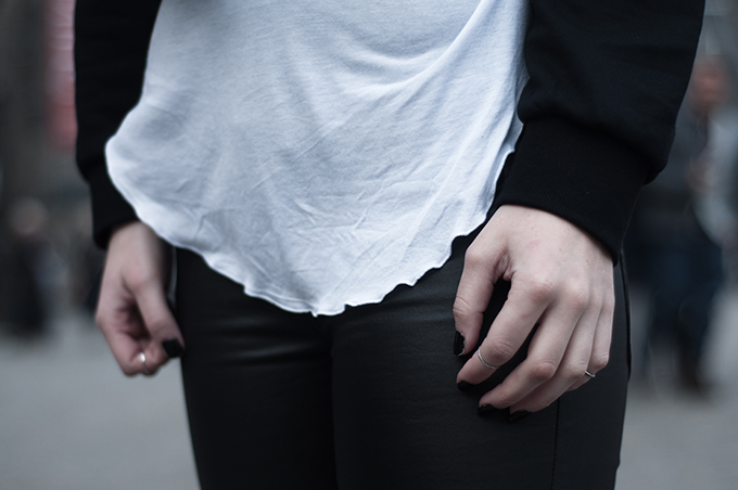 RED REIDING HOOD: Layers black and white streetstyle cropped sweater crop top above knuckle rings leather pants