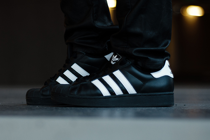 adidas superstar black wearing
