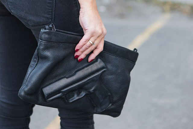 RED REIDING HOOD: Rihanna Vlieger & Vandam gun clutch guardian angel tote bag designer pouch all black everything outfit details fashion inspiration streetstyle