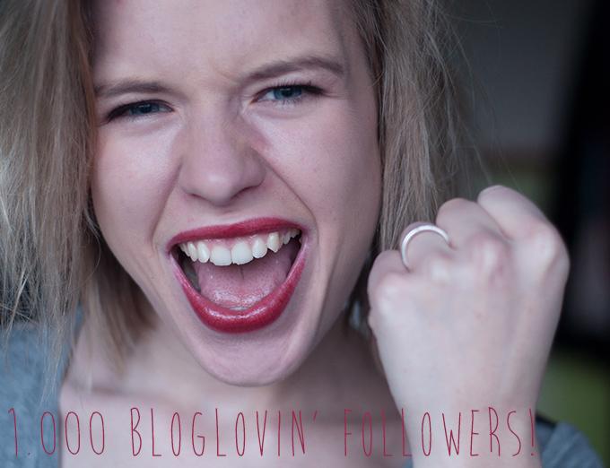 RED REIDING HOOD: Girl cheering happy fashion blogger red lipstick 1000 bloglovin followers milestone fuck yeah