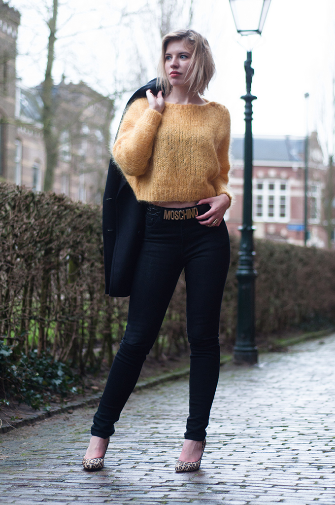 RED REIDING HOOD: Fashion blogger wearing high waisted jeans streetstyle mohair jumper moschino belt model off duty leopard heels