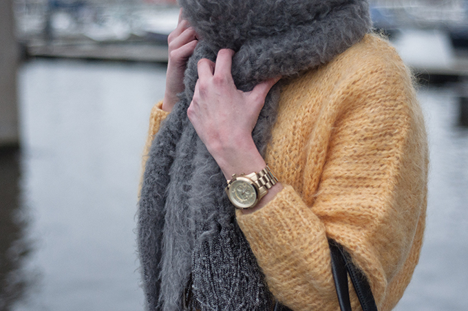 RED REIDING HOOD: Fashion blogger wearing gold oversized Michael Kors watch fluffy grey scarf big yellow mohair sweater H&M Trend model off duty streetstyle