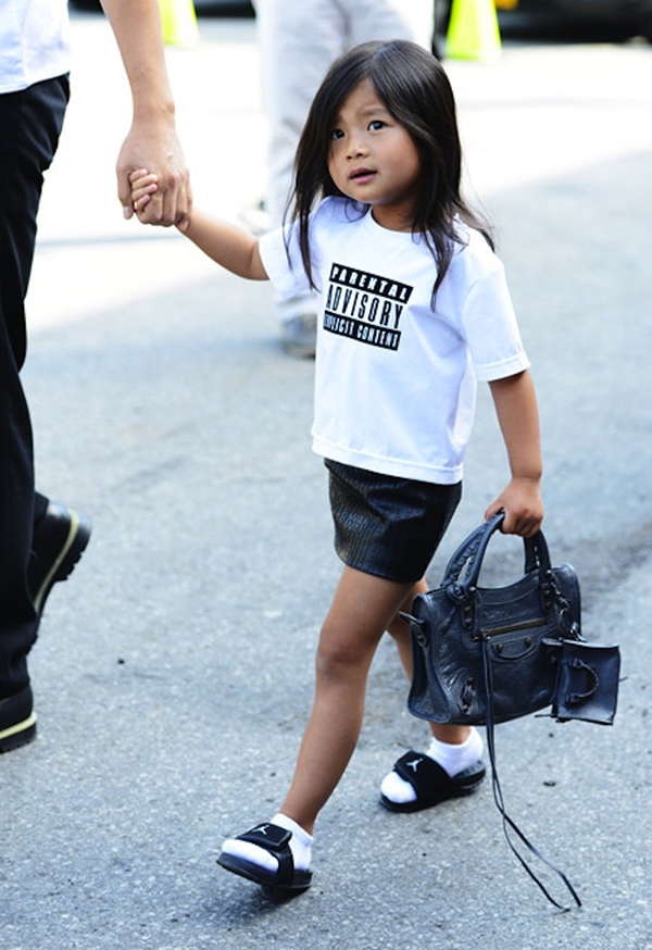RED REIDING HOOD: Streetstyle Alexander Wang parental fashion advisory niece Alaia Wang wearing Nike slides slippers flipflops