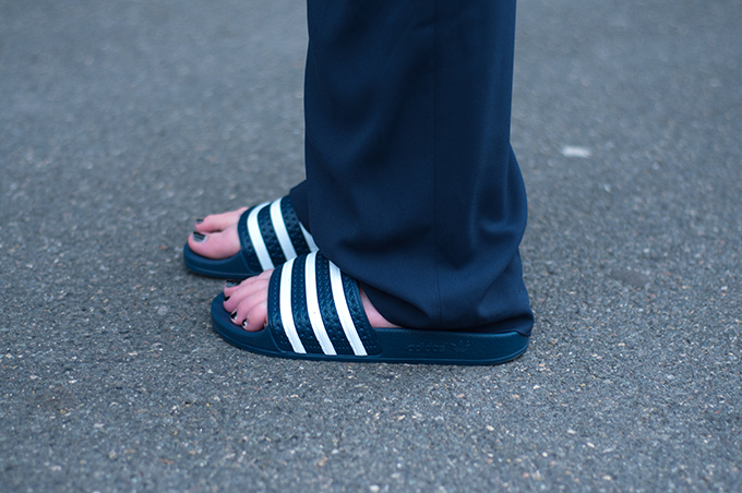 RED REIDING HOOD: Fashion blogger wearing Adidas Adilette slides Birkenstock sandals wide leg pants streetstyle