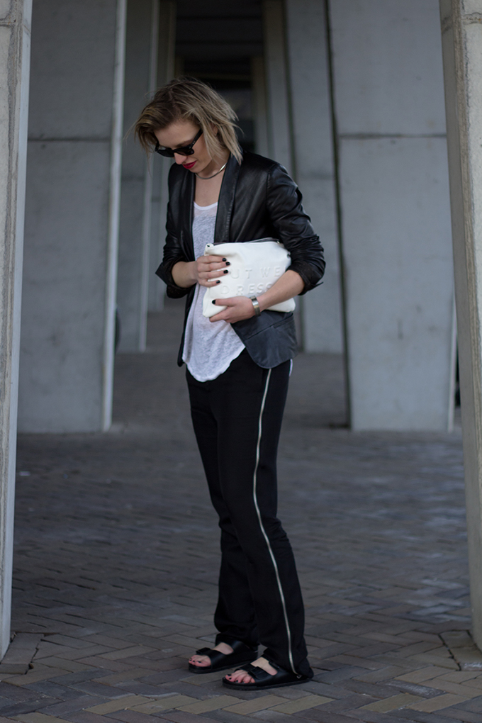 RED REIDING HOOD: Fashion blogger wearing black and white outfit birkenstock arizona slides slouchy pants nowhere leather suit jacket zara clutch streetstyle