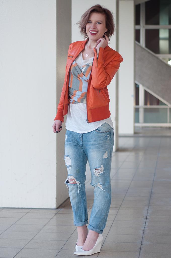 RED REIDING HOOD: Fashion blogger wearing orange leather jacket BlueGold boyfriend jeans streetstyle model off duty outfit