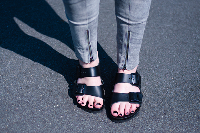 RED REIDING HOOD: Fashion blogger wearing Birkenstock Monterey slides streetstyle all black birkenstocks model off duty grey leather pants