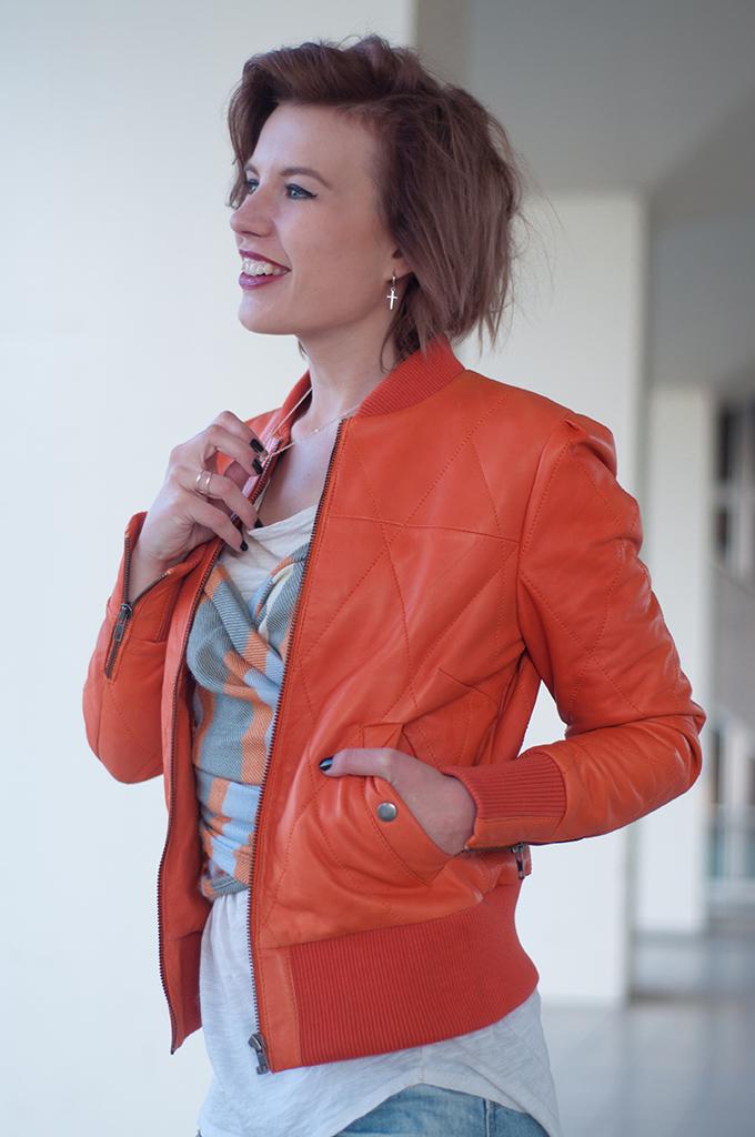 RED REIDING HOOD: Fashion blogger wearing orange leather jacket BlueGold streetstyle model off duty look