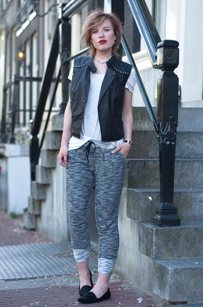 RED REIDING HOOD: Fashion blogger wearing knitted joggers knit pants sleeveless leather jacket waist coat streetstyle