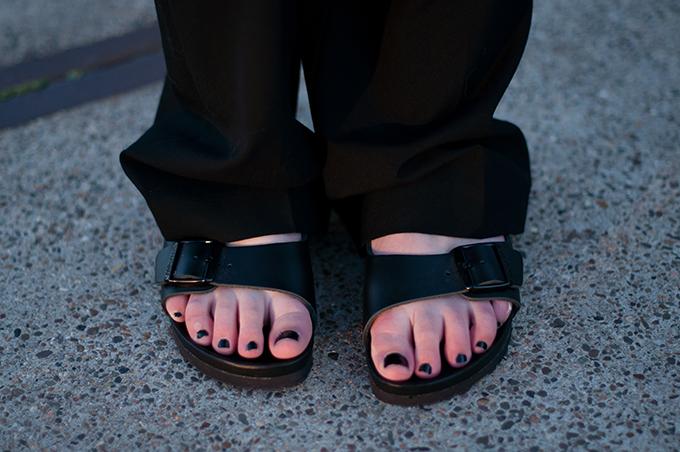 RED REIDING HOOD: Fashion blogger wearing wide legged slouchy pants and Birkenstock monterey slides streetstyle birkenstocks all black everything look