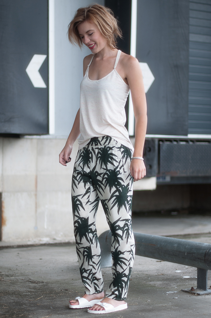 RED REIDNG HOOD: Fashion blogger wearing ganni palm printed pants streetstyle birkenstock slides model off duty easy summer look