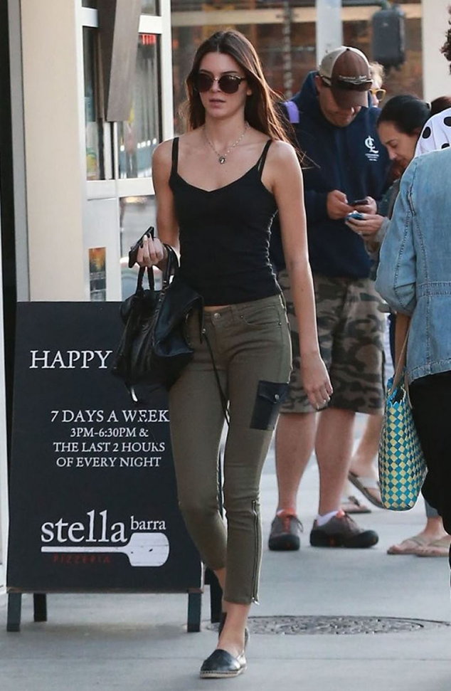 RED REIDING HOOD: Model off duty look Kendall Jenner green cargo pants