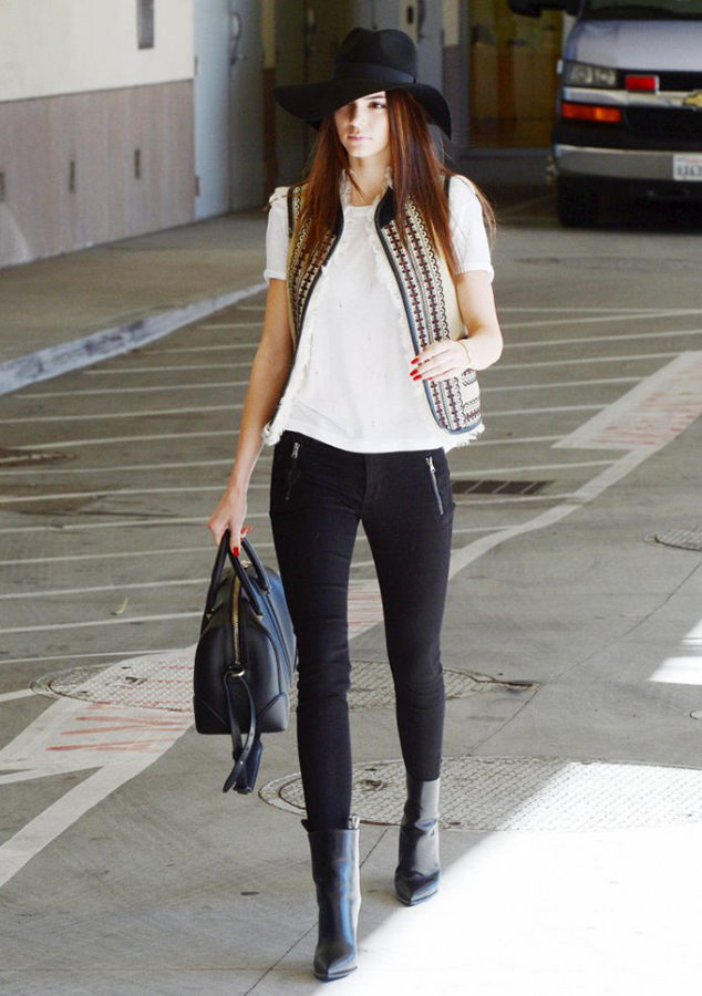 RED REIDING HOOD: Street style Kendall Jenner model off duty outfit floppy hat gilet black jeans look