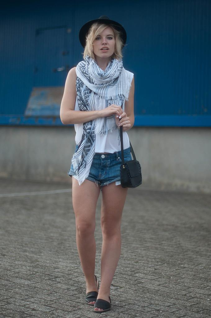 RED REIDING HOOD: Fashion blogger wearing One Teaspoon Bandits shorts street style fedora hat model off duty festival look