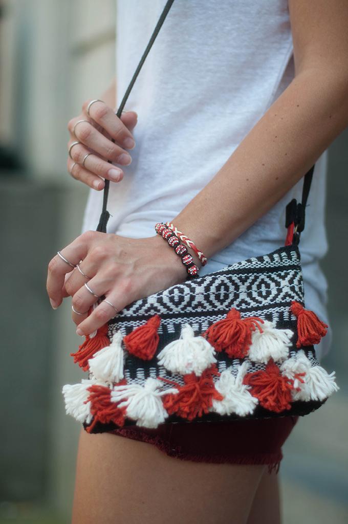 RED REIDING HOOD: Fashion blogger wearing boho tassels bag festiavl look multiple rings outfit