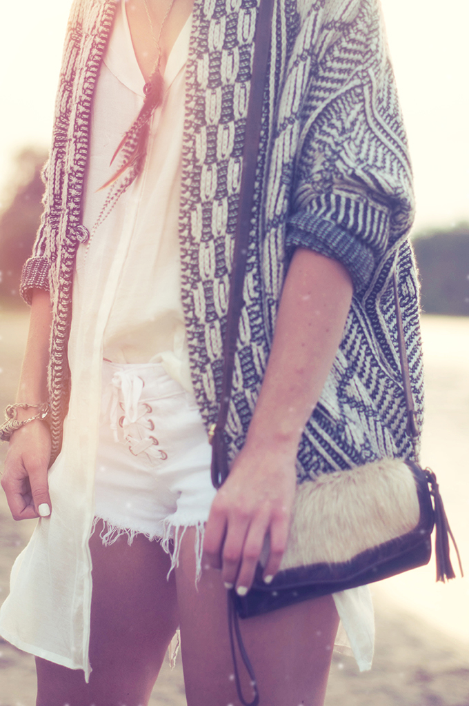 RED REIDING HOOD: Fashion blogger wearing bohemain outfit layers lace up shorts boho look feather necklace heavy knit cardigan