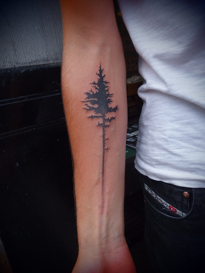 RED REIDING HOOD: Fade out pine tree tattoo arm placement ink inspiration