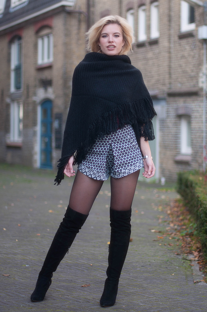 RED REIDING HOOD: Fashion blogger wearing structured origami shorts primark outfit over the knee boots street style poncho cape