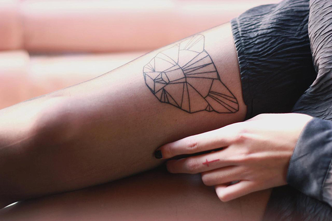 RED REIDING HOOD: Geometric lion head tattoo upper leg placement inspiration ink tat
