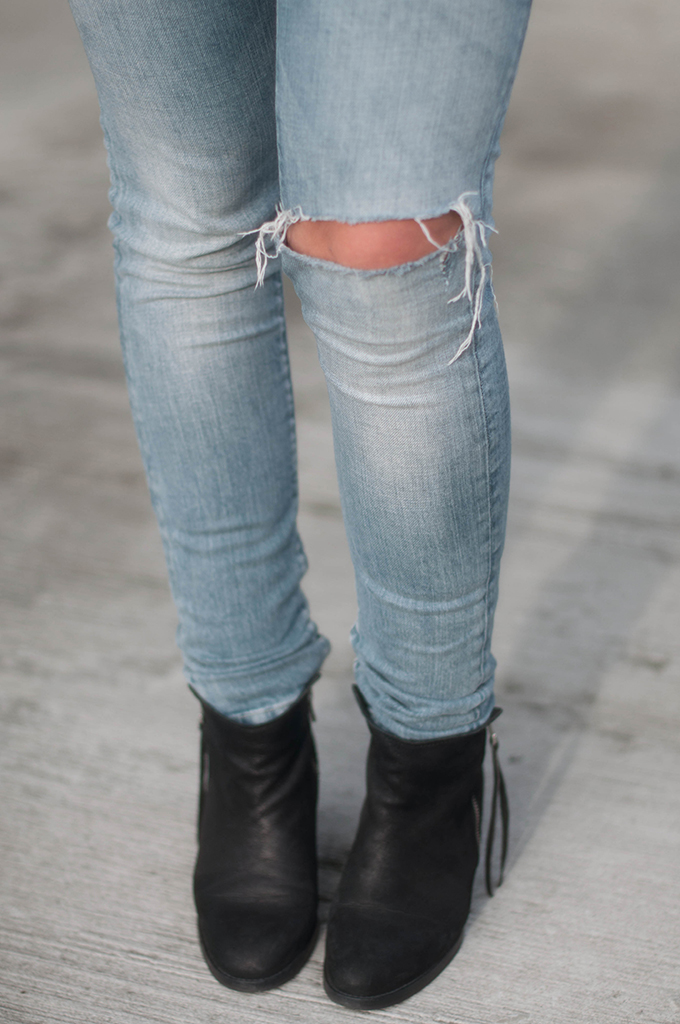 RED REIDING HOOD: Fashion blogger wearing distressed jeans slashed ripped knee denim look acne pistol boots