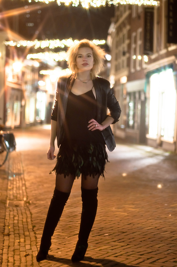 RED REIDING HOOD: Fashion blogger wearing leather suit jacket feather skirt street style over the knee boots outfit