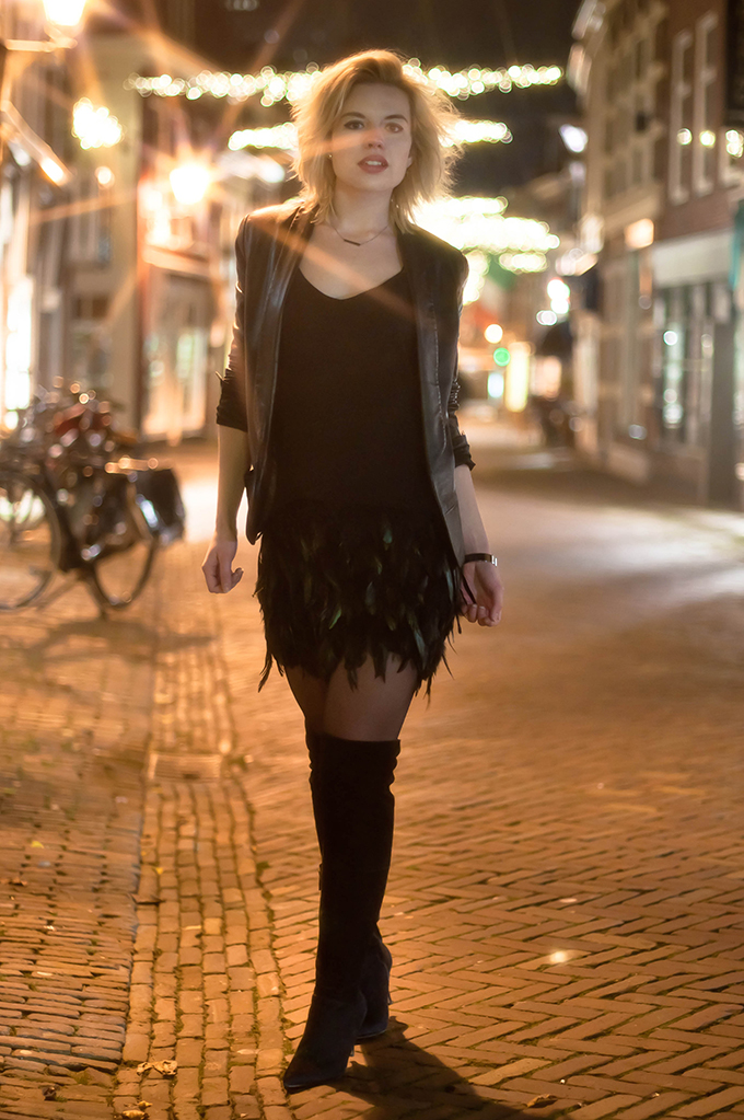RED REIDING HOOD: Fashion blogger wearing over the knee boots street style feather skirt nigh photography
