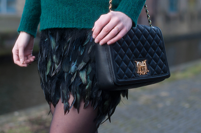 RED REIDING HOOD: Fashion blogger wearing feather skirt love moschino quilted designer bag outfit details